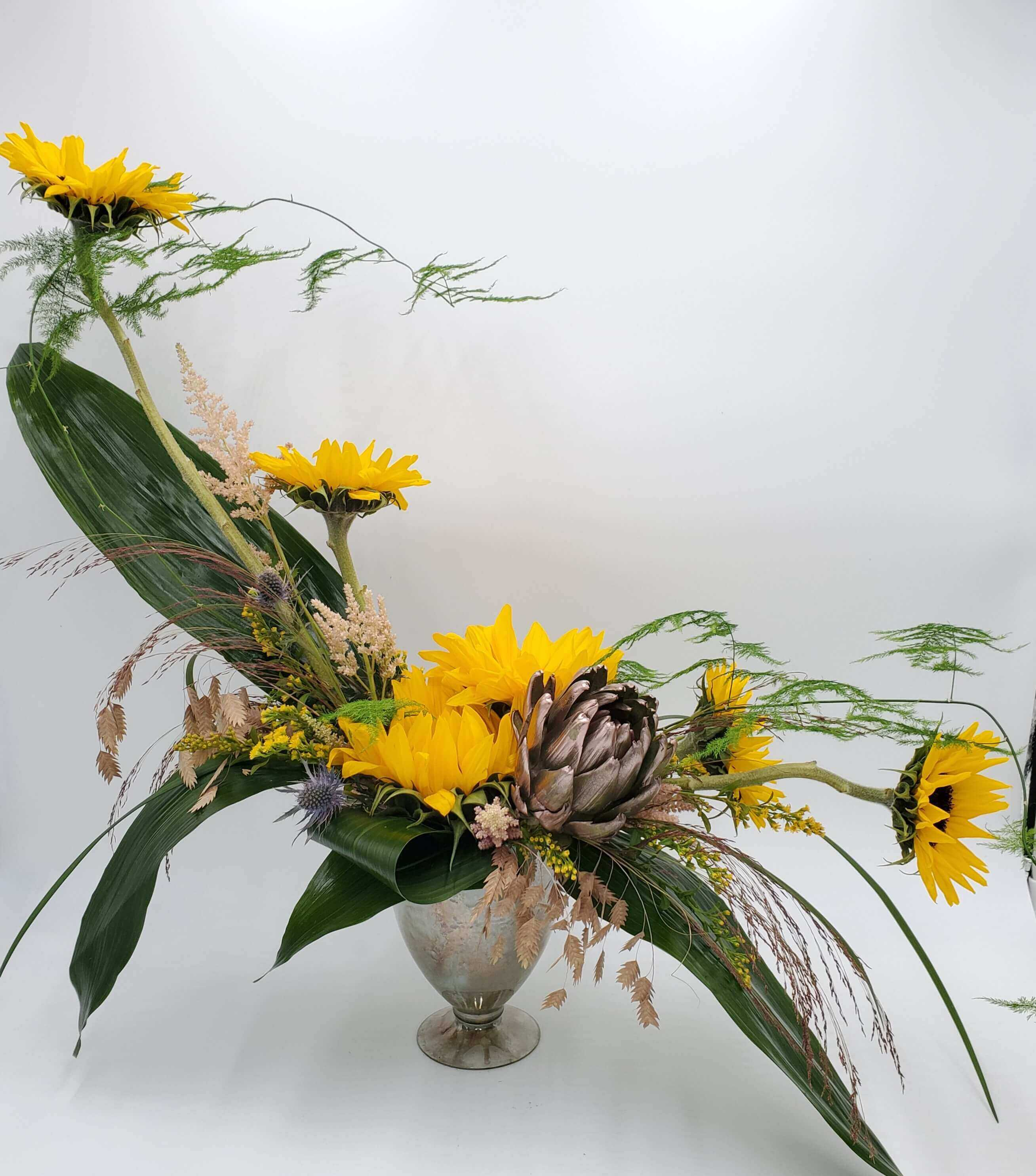 Artistic sunflower floral arrangement