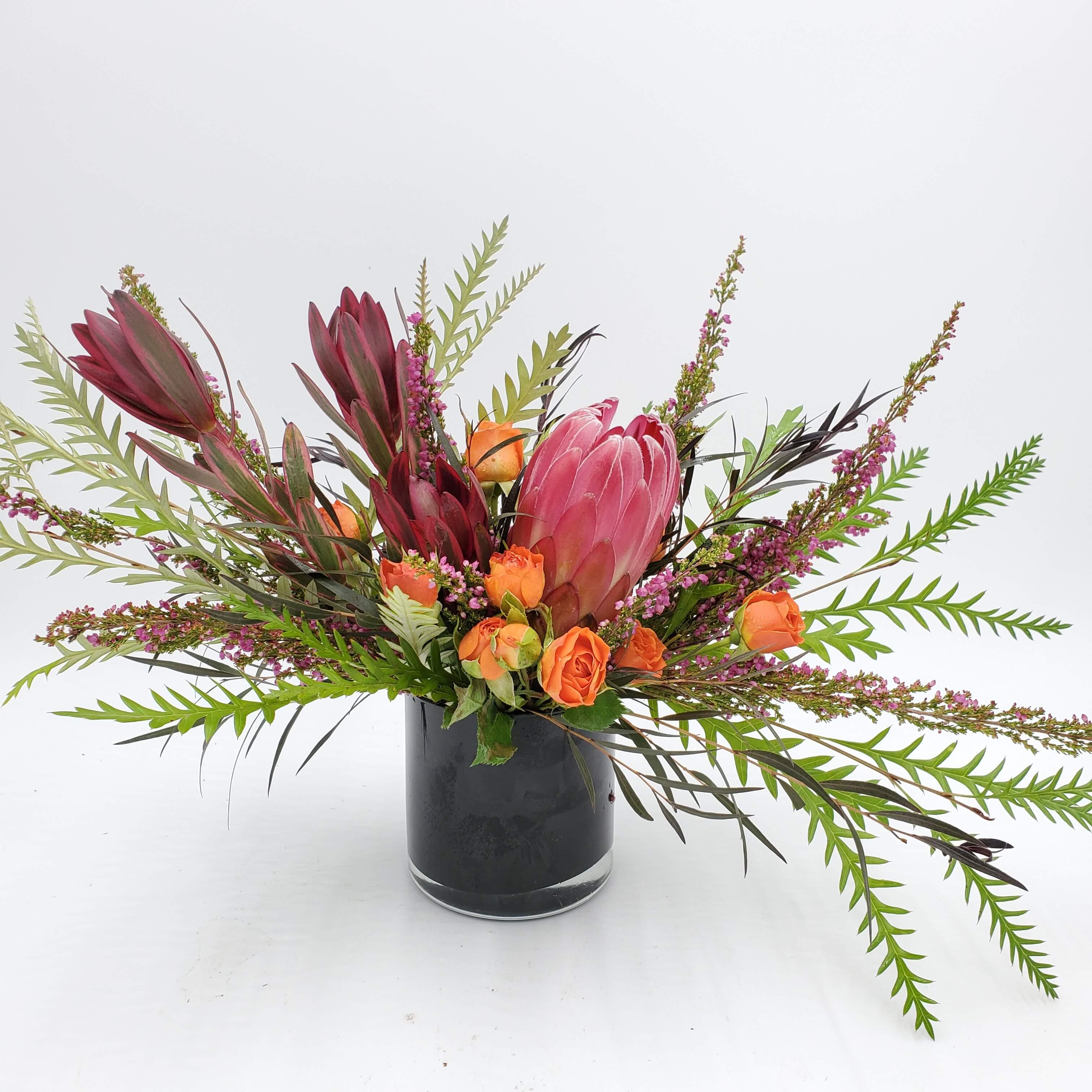 Naturalistic floral design pinks and oranges
