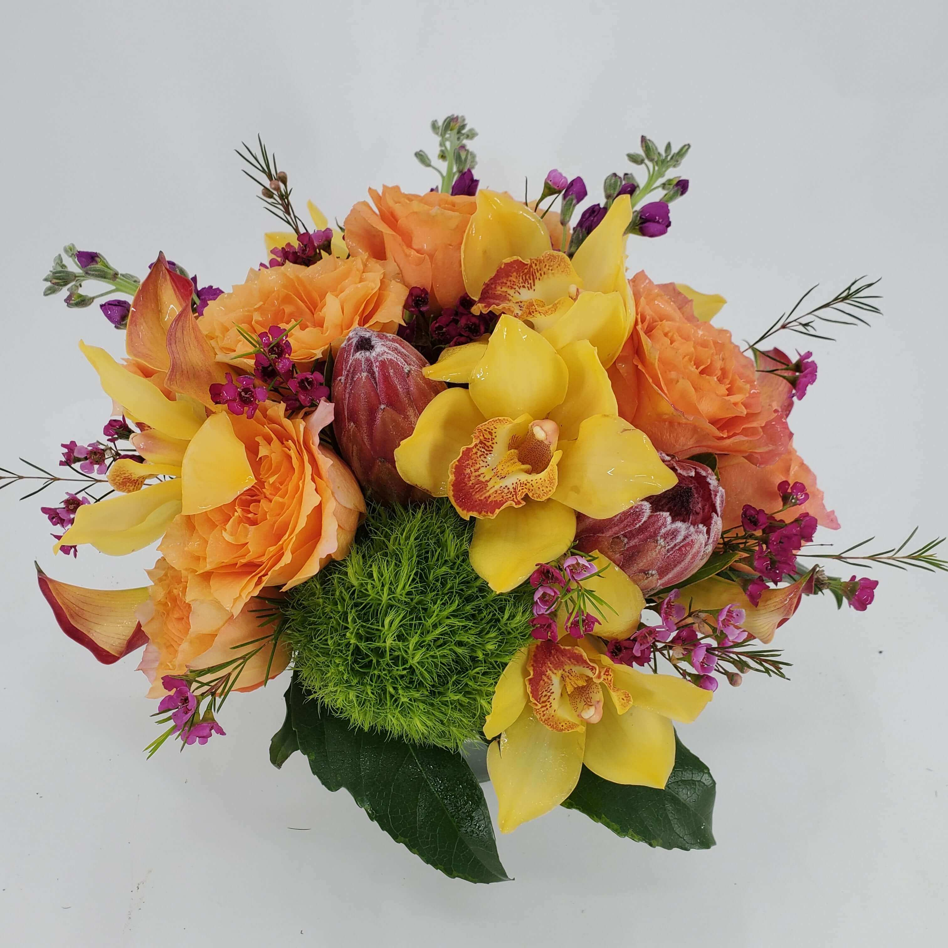 Traditional orange and yellow flower arrangement